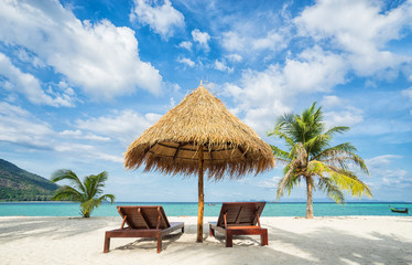 Poster Zanzibar Beach chairs, umbrella and palms on the beach. Thailand. Koh Lipe island.