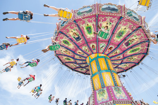 Colorful, traditional fairground ride on a sunny day