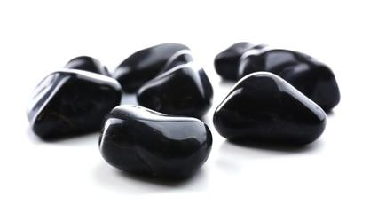 Black onyx pile isolated on white background