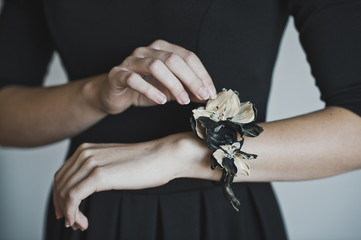 The corsage on the girls hand 4469.