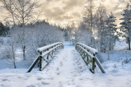 Snowy, wooden bridge in a winter day. Stare Juchy, Poland.