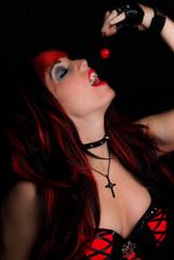 Vampire Woman Eating Cherry