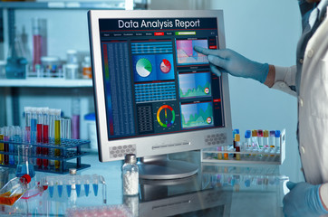 researcher touching the screen of report research data / analyzing data scientist in the laboratory with a screen project development