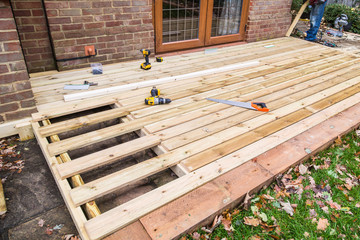 Wooden decking, deck, patio construction.