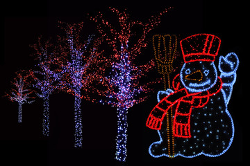 Illuminated Snowman and trees