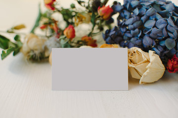 Empty blank on the background of dried flowers