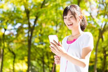 young asian woman jogging image