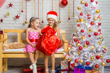 Two girls discover a bag of gifts