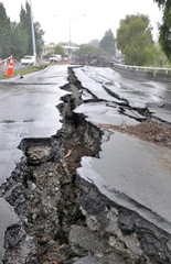 Enormous cracks in a road caused by a devastating earthquake on a rainy day in Christchurch, New Zealand.