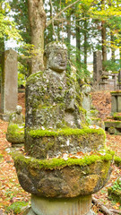 Old stone image of Buddha in Nikko temple, Japan