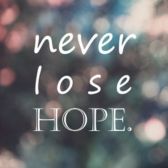 "typography motivational life quote ,""never lose hope"" on blur bokeh background, color filter"