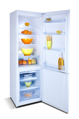 Refrigerator open with fresh food. Isolated on white