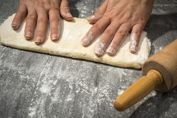 making dough on stone table