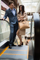 Young couple on the escalator