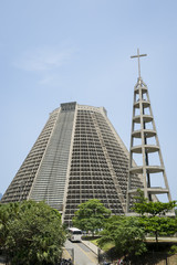 The Metropolitan Cathedral of Rio de Janeiro is a modernist landmark designed after a Mayan pyramid that stands in the Centro area of downtown Rio, Brazil