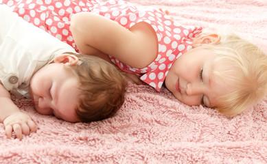 Children lie on the mat