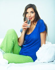 Beautiful Woman drinking water from glass.