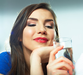 Smiling female model portrait with water glass.