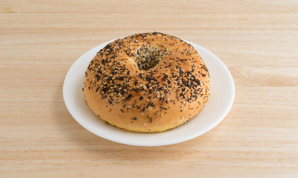 Every seasoning bagel on a white plate