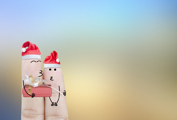 Couple finger and gift on christmas holiday abstract background