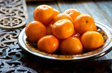 Fresh tangerines on wooden table