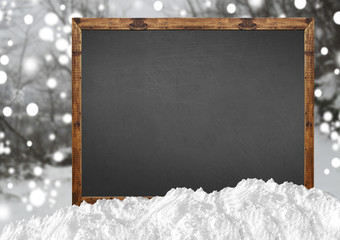 Blank blackboard with blurr forest and snow