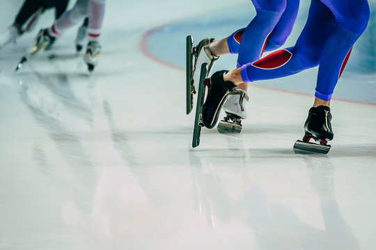legs male skaters during warm-up before competitions in speed skating