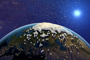 Snowing. The planet Earth from space showing Europe. The globe is covered with snow on space background. Fantastic background. Elements of this image furnished by NASA