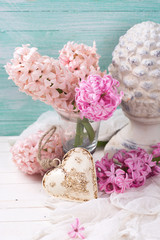 Pink  hyacinths,  decorative heart and  terracotta cone