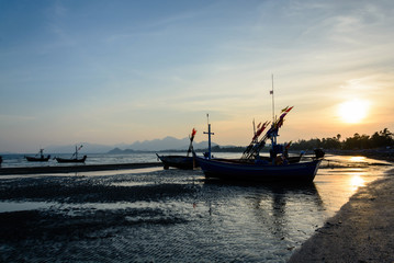 silhouette of Traditional wooden fishing boats on the beach at s