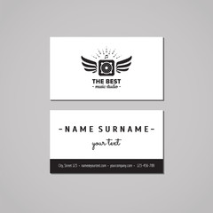 Music studio business card design concept. Music studio logo with music speaker and wings. Vintage, hipster and retro style. Black and white.
