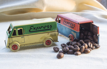 toy trucks carrying coffee beans