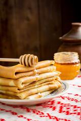 Stack of pancakes with honey. Russian blini for Maslenitsa