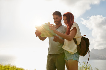 Couple looking for directions on map