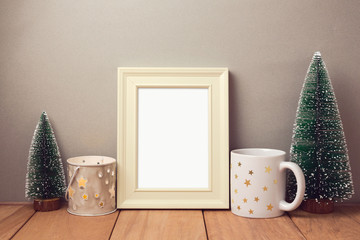 Poster mock up template for Christmas holiday with cup and small pine trees