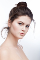 Beautiful cute young brunette girl posing in the studio. Natural pure daily makeup.