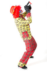 Clown spielt Trompete
