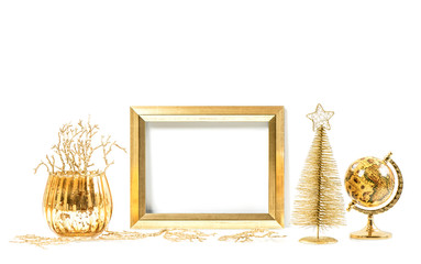 Golden frame and Christmas ornaments. Mock up for picture