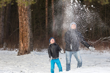 Dad and son playing in snow