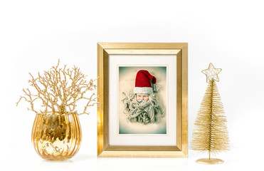 Golden frame and Christmas ornaments. Vintage style Santa Claus