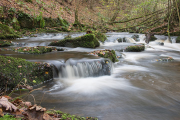 The River Duhonw tumbles over waterfalls as it heads towards Bluith Wells in Wales