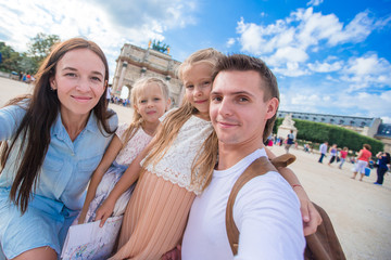 Happy family with two kids in Paris on summer vacation