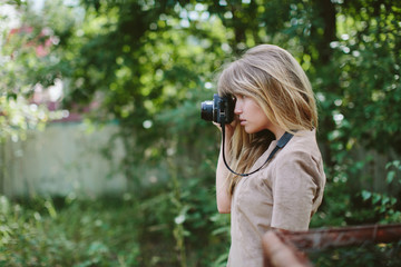 young beautiful girl with vintage camera