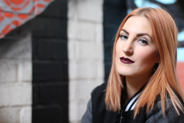Androgynous Young Woman with Red Hair