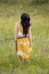 Back of Woman Wearing Long Dress in Field