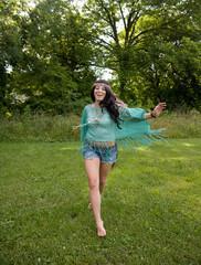 Hippie Girl Running Barefoot Through Grass