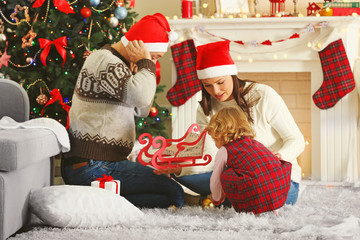 Happy Family on Christmas tree background