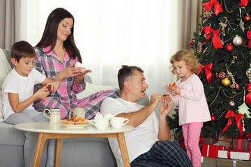 Christmas family portrait at breakfast in home holiday living room, at morning