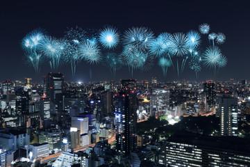 Fireworks celebrating over Tokyo cityscape