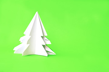 Origami Christmas tree paper on green background